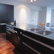 Kitchen with dark coloured cabinetry, stainless steel benchtop cabinetry, countertop, floor, glass, interior design, kitchen, sink, gray, black