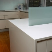 An example of the products used by The cabinetry, chest of drawers, countertop, drawer, floor, furniture, glass, hardwood, kitchen, plywood, product, product design, property, table, wood, wood stain, gray