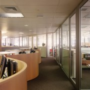 A view of the offices, carpet, glass slides, ceiling, daylighting, institution, interior design, office, brown
