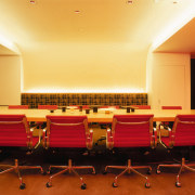 A view of the confrence room, carpet, cream auditorium, ceiling, conference hall, convention center, function hall, interior design, room, table, orange