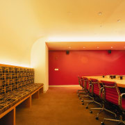 A view of the confrence room, carpet, cream architecture, auditorium, ceiling, conference hall, floor, flooring, function hall, interior design, lighting, table, wall, orange