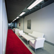 A view of the hallway in the office, architecture, ceiling, daylighting, furniture, interior design, office, product design, table, gray