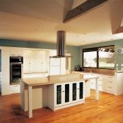 Examples of kitchens designed by Genesis, who also cabinetry, countertop, cuisine classique, floor, flooring, hardwood, interior design, kitchen, real estate, room, wood flooring, brown, orange