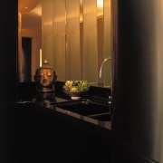 A close up view of the sink area, ceiling, countertop, interior design, light, light fixture, lighting, room, under cabinet lighting, black