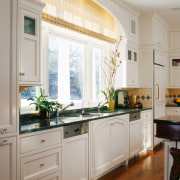view of the kitchen where symmetry contributes to cabinetry, countertop, cuisine classique, home, interior design, kitchen, room, window, gray