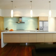 View of kitchen with long island, stainless steel architecture, cabinetry, ceiling, countertop, cuisine classique, floor, flooring, hardwood, interior design, kitchen, real estate, room, wood flooring, brown, gray