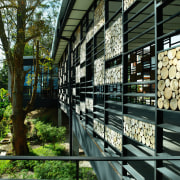 view of the striking design feature, the cladding architecture, plant, tree, black