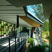 view of the covered walkways. the ceilings vary architecture, daylighting, home, house, roof, window, black, green