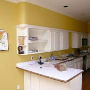 before shots of this narrow kitchen that is cabinetry, countertop, home, interior design, kitchen, real estate, room, orange, brown, gray
