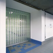 View of slotted aluminium roller shutter door. - architecture, daylighting, glass, wall, gray, white