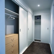 View of wardrobe system in apartment. - View closet, door, real estate, room, wardrobe, gray
