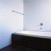 Bathroom with white bath and walls and dark angle, bathroom, bathroom sink, bathtub, daylighting, floor, interior design, plumbing fixture, product design, property, room, tap, tile, wall, white