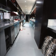 View of bar with timber cabinetry, featuring grey interior design, black, gray