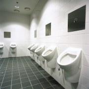 Men's bathroom with wall mounted sanitaryware. - Men's architecture, bathroom, ceramic, daylighting, floor, flooring, interior design, plumbing fixture, product design, public toilet, sink, tap, tile, toilet, urinal, wall, gray, white