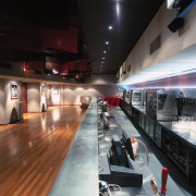 View of bar area with varied lighting, timber interior design, black, gray
