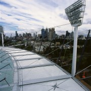 View of stadium roofing showing panels and cabling. architecture, building, city, condominium, metropolitan area, roof, sky, skyscraper, structure, urban area, gray, black