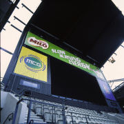 View of large screen and advertising at sports advertising, building, car, sport venue, structure, technology, black