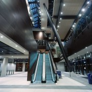 Interior of MCG entranceway showing large atrium, extensive airport terminal, architecture, building, daylighting, escalator, metropolitan area, structure, black, gray