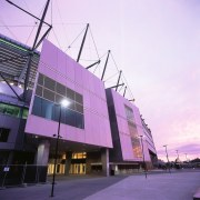 Exterior view of refurbished Melbourne Cricket Ground entrance. architecture, building, commercial building, convention center, corporate headquarters, facade, metropolis, metropolitan area, mixed use, purple, sky, sport venue, structure, tourist attraction, purple