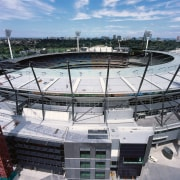 View of MCG stadium with extensive roofing. - arena, sport venue, stadium, structure, gray, black