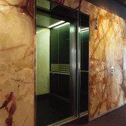 View of open lift with marble wall panels floor, flooring, glass, wall, brown, black