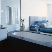 Bath with black tile surround, white vanity with bathroom, bathroom accessory, bathroom cabinet, bathroom sink, floor, interior design, plumbing fixture, product design, room, sink, tap, gray