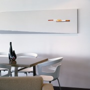 Dining area with white walls and long artwork furniture, interior design, light fixture, lighting, product design, shelf, table, wall, white