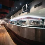 Bar area with long curved counter and bulkhead architecture, interior design, black