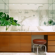 view of this bathroom featuring marble vein walls,floor furniture, interior design, product design, table, wall, white, brown
