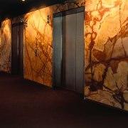 Lift lobby area with black granite floor tiles art, art exhibition, modern art, tourist attraction, black