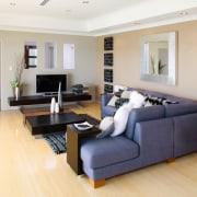 Lounge area with cream walls, timber flooring, blue floor, flooring, furniture, hardwood, home, interior design, laminate flooring, living room, property, real estate, room, wood, wood flooring, white