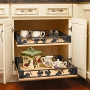 Traditional cream kitchen cabinetry with pull out cabinet cabinetry, drawer, furniture, product, shelf, shelving, orange, brown