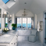 view of this bathroom featuring featuring raised bathtub bathroom, ceiling, estate, home, interior design, property, real estate, room, window, gray