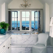 view of this bathroom featuring featuring raised bathtub floor, home, interior design, living room, room, wall, window, gray