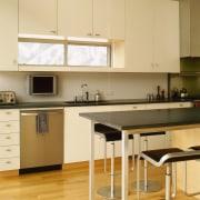 A view of the kitchen area, wooden flooring cabinetry, countertop, cuisine classique, floor, interior design, kitchen, product design, room, orange, brown