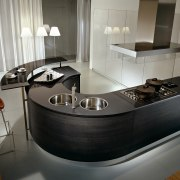 A view of a Pedini kitchen, with curved countertop, furniture, interior design, kitchen, product design, gray, black