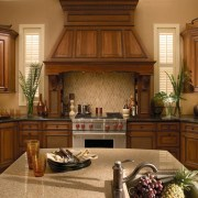 Traditional style kitchen with marble island with sink, cabinetry, countertop, cuisine classique, estate, furniture, hardwood, home, interior design, kitchen, room, under cabinet lighting, wood, brown