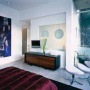 A view of the master bedroom, concrete flooring, ceiling, interior design, living room, room, wall, gray