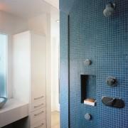A view of the bathroom, white walls, mirror, bathroom, bathroom accessory, bathroom cabinet, blue, home, interior design, plumbing fixture, room, tile, wall, gray