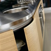Kitchen cabinetry with curved oak veneer doors and furniture, product design, table, gray, black, orange