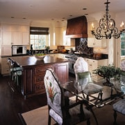 Traditional style kitchen and dining room showing steam countertop, dining room, interior design, kitchen, living room, room, black