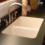 View of kitchen countertop showing undermount sink. bathroom sink, countertop, floor, plumbing fixture, product design, sink, tap, orange, black
