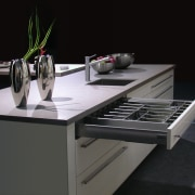 White and grey kitchen with large drawers and countertop, furniture, product design, table, black