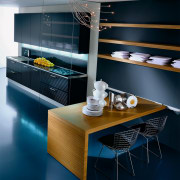A view of a Pedini kitchen, with dark architecture, furniture, interior design, kitchen, product design, room, table, blue