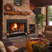 Lounge room with large stone fireplace, open fire fireplace, hearth, home, interior design, living room, wood burning stove, brown, red