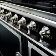 Closeup view of cooker control handles. - Closeup automotive design, car, metal, motor vehicle, black, gray