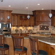 Kitchen with timber cabinetry, granite countertops, stainless steel cabinetry, countertop, cuisine classique, flooring, hardwood, interior design, kitchen, room, brown