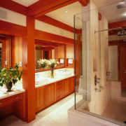view of this bathroom featuring cherry wood vanity/cabinetry, cabinetry, ceiling, countertop, interior design, kitchen, real estate, room, red, orange, brown