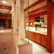 view of this bathroom featuring cherry wood vanity/cabinetry, cabinetry, ceiling, countertop, cuisine classique, interior design, kitchen, real estate, room, orange, red