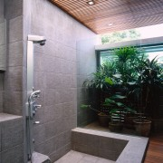 view of this bathroom that has a natural architecture, bathroom, interior design, real estate, gray, black